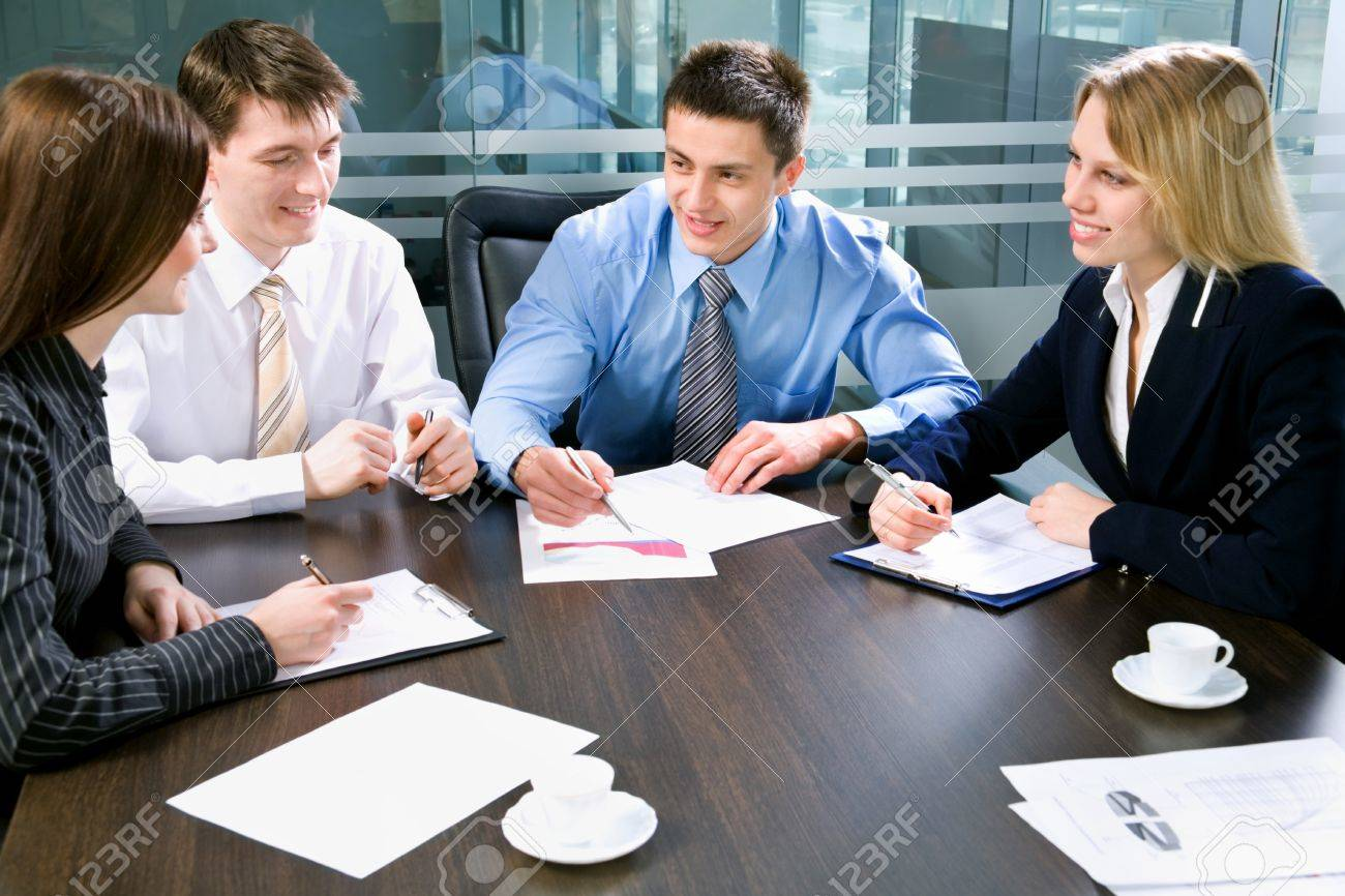 Image of four business people working at meeting Stock Photo - 10492858