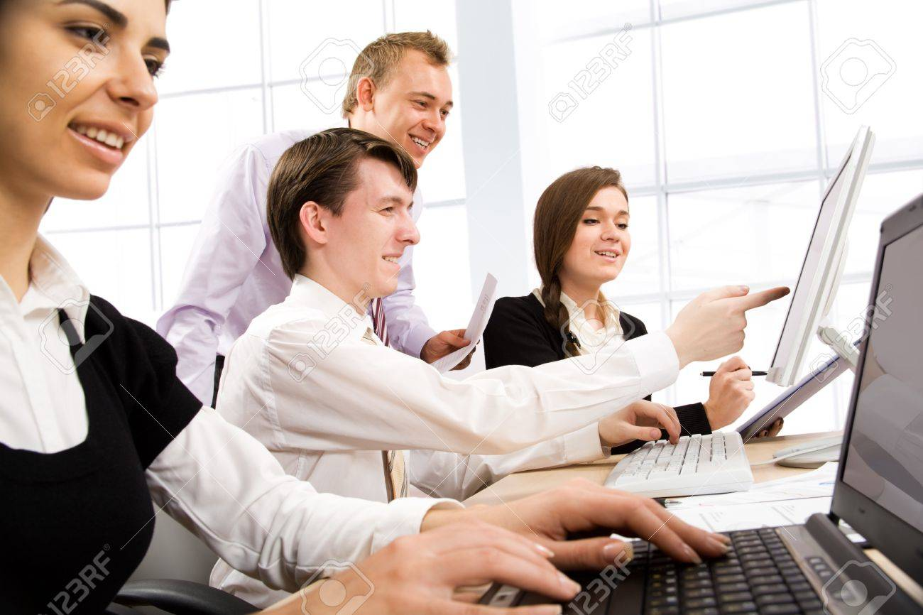 Business team at a meeting in a light and modern office environment Stock Photo - 10672243