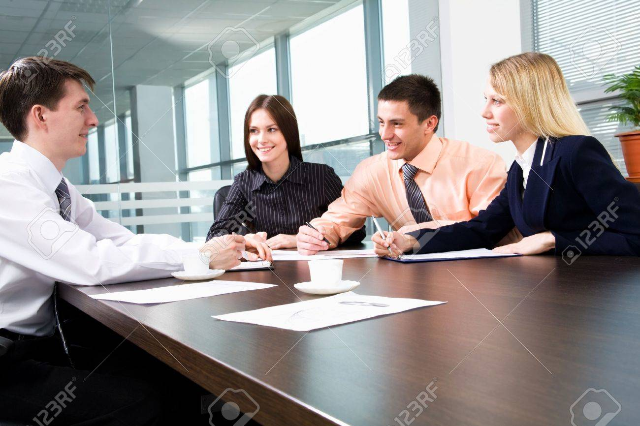 business team at a meeting in a modern office environment stock business team at a meeting in a modern office environment stock photo 11010567