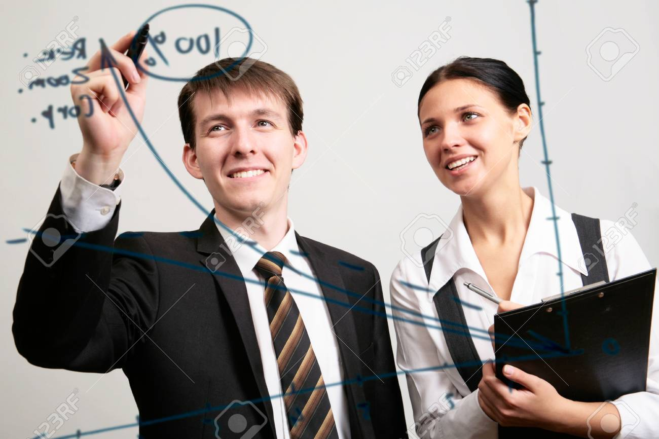 Businessman drawing a graph on a glass window in an office Stock Photo - 11508803