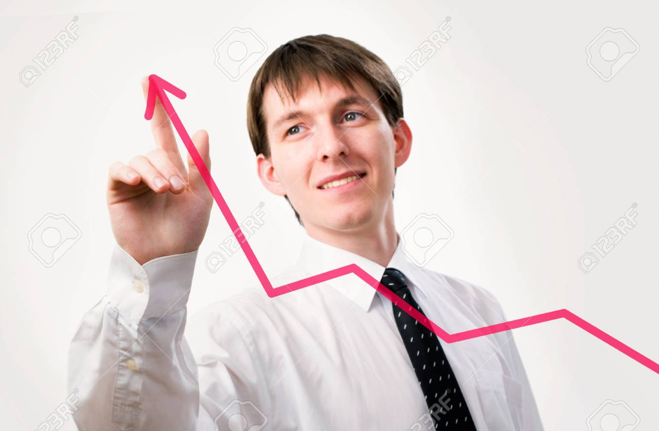 Businessman pointing on the graph in an office - focus is on graph Stock Photo - 12150703