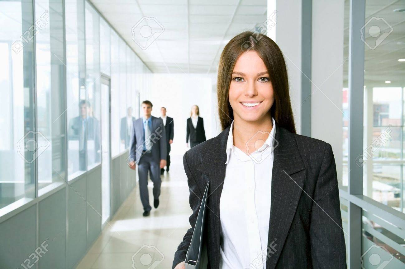 nice business woman walking down the corridor office stock photo 12836693 person