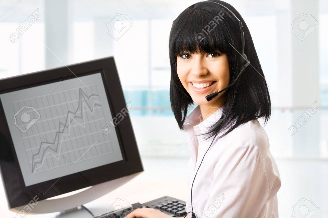 beautiful business customer service woman - smiling in an office Stock Photo - 13622809