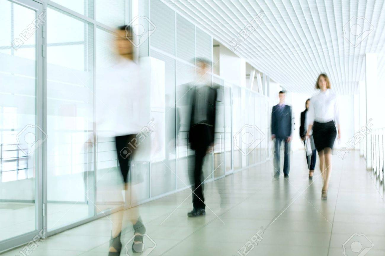 Business people walking in the office corridor Stock Photo - 14735018