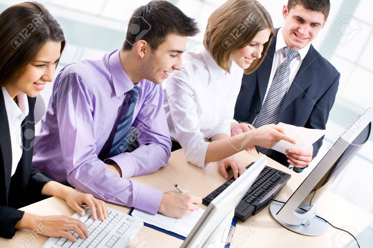 Group of happy multi ethnic business people in a meeting at office Stock Photo - 14735166