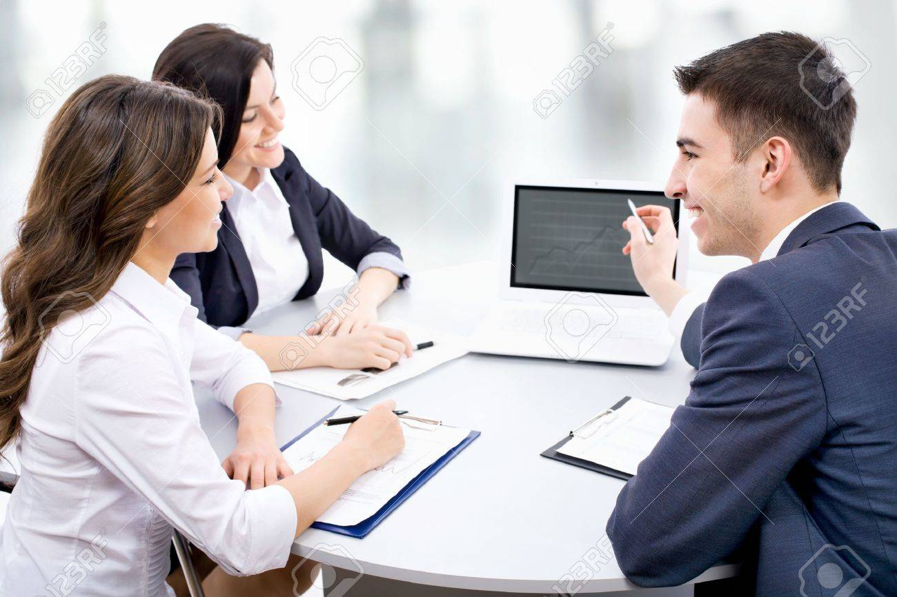 Young Business People Discuss The New Project At Office Stock Photo,  Picture And Royalty Free Image. Image 15110316.
