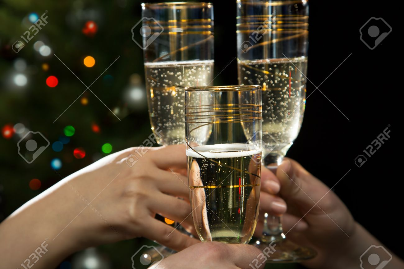 Happy Christmas. Image of people hands with crystal glasses full of champagne Stock Photo - 16104053