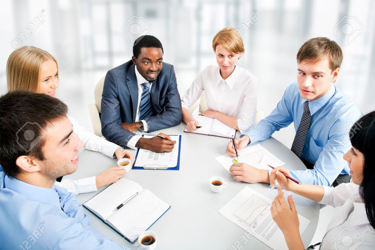 Business People Working Together A Diverse Work Group Stock Photo