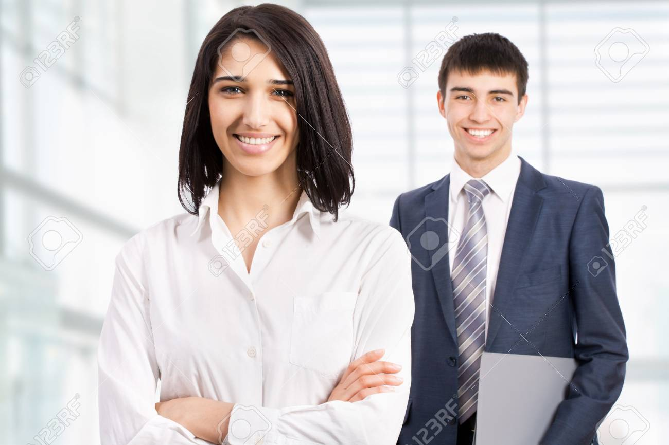 Business woman standing in front of her colleague Stock Photo - 17516604