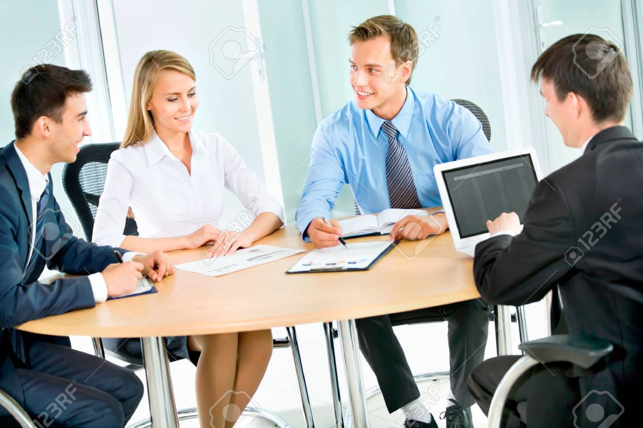Business people. Business team working on their business project together at office. - 18609408
