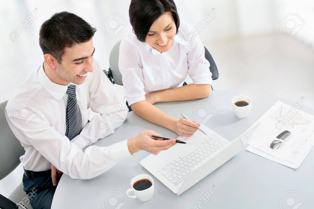 Young business people working in the office Stock Photo - 19164055