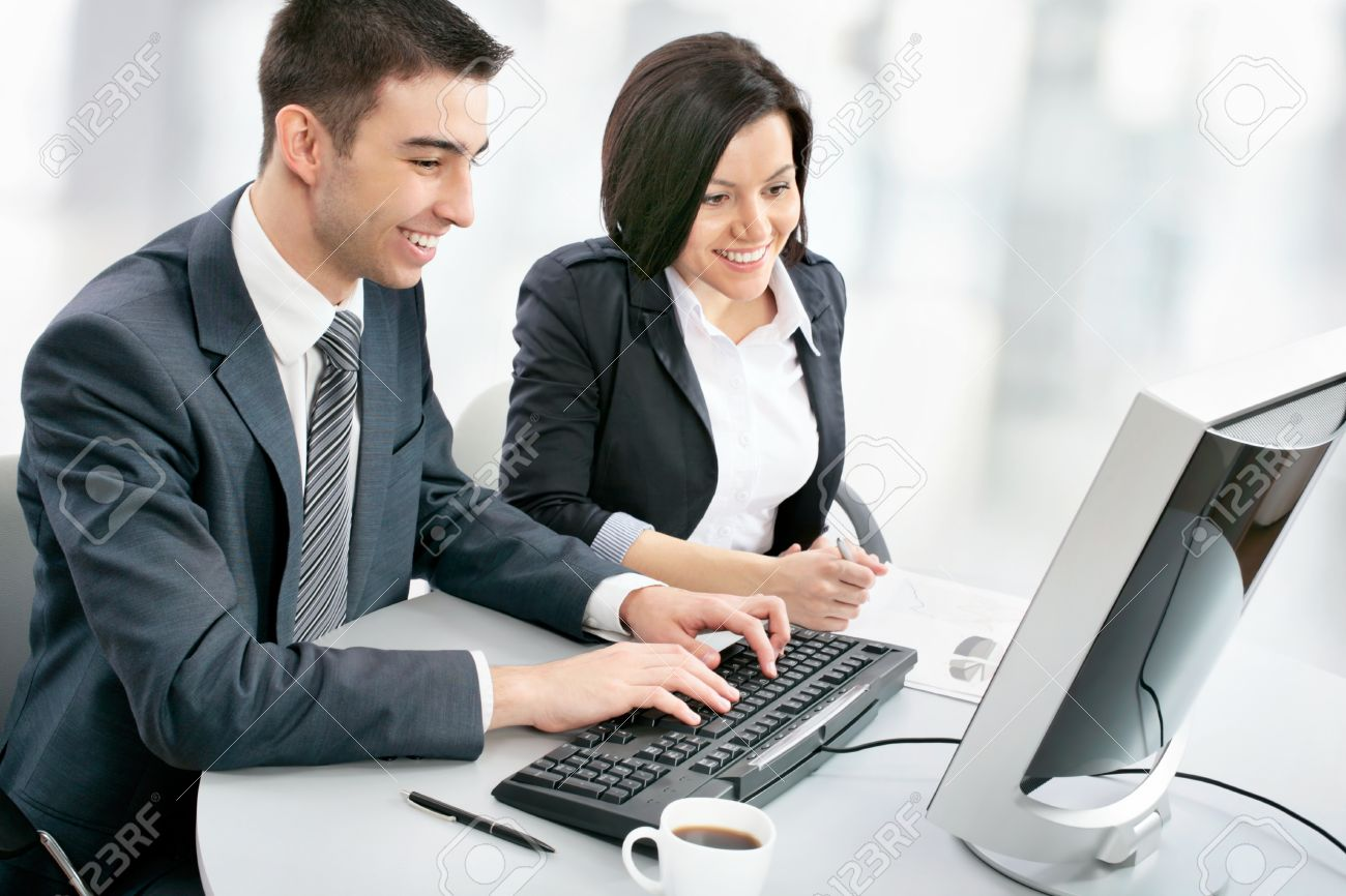 smiling business people with computer in board room stock photo 19164060 business computer