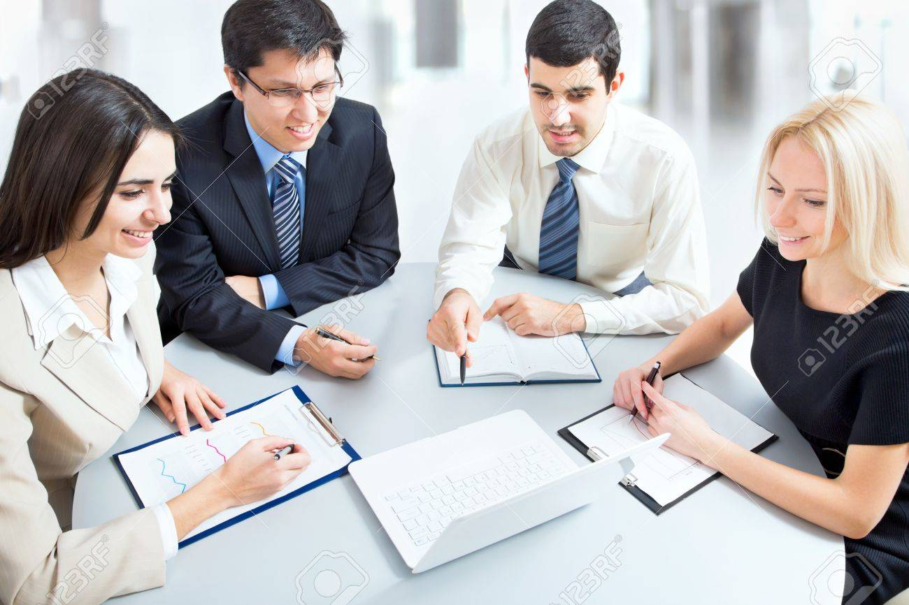 Business team working on their business project together at office Stock Photo - 20751603