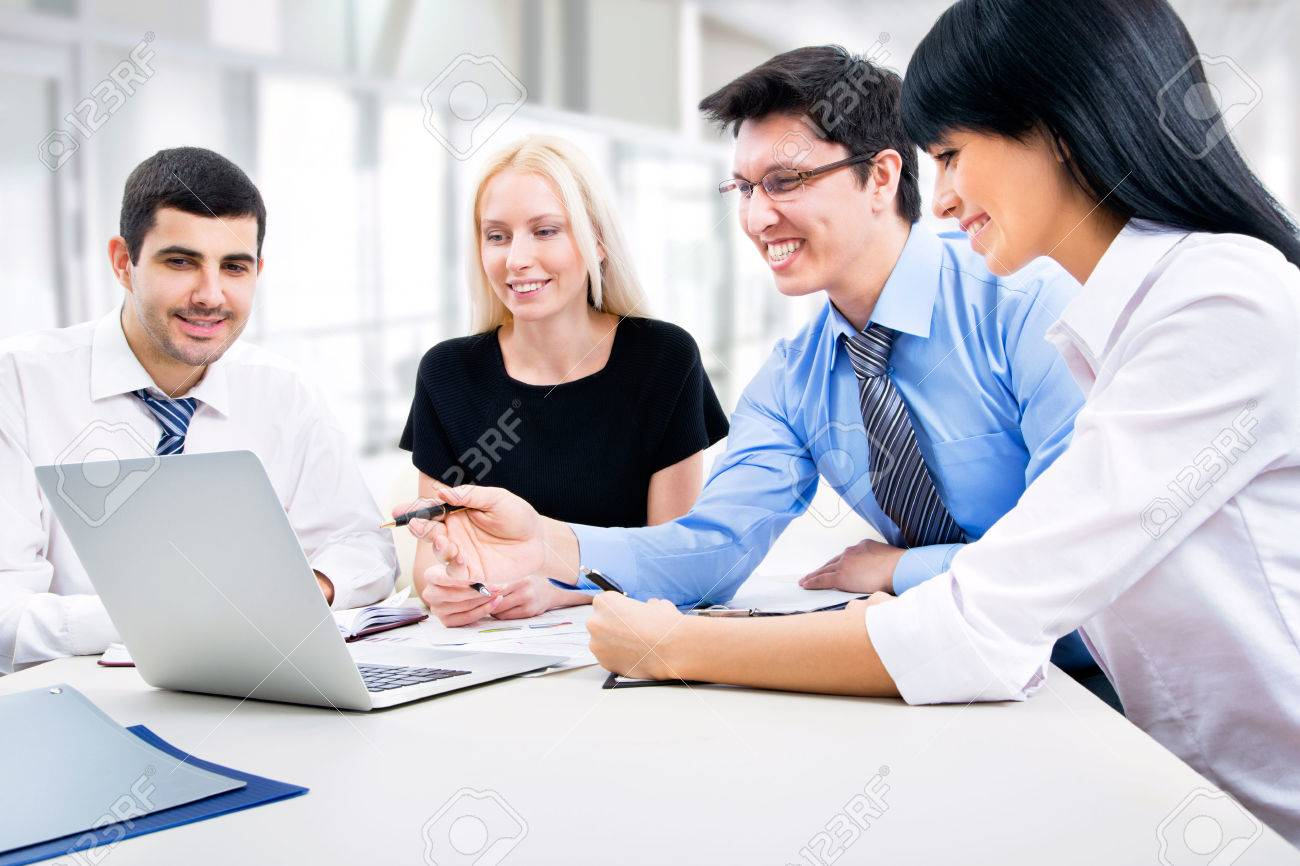Business people working with laptop in an office Stock Photo - 22342295