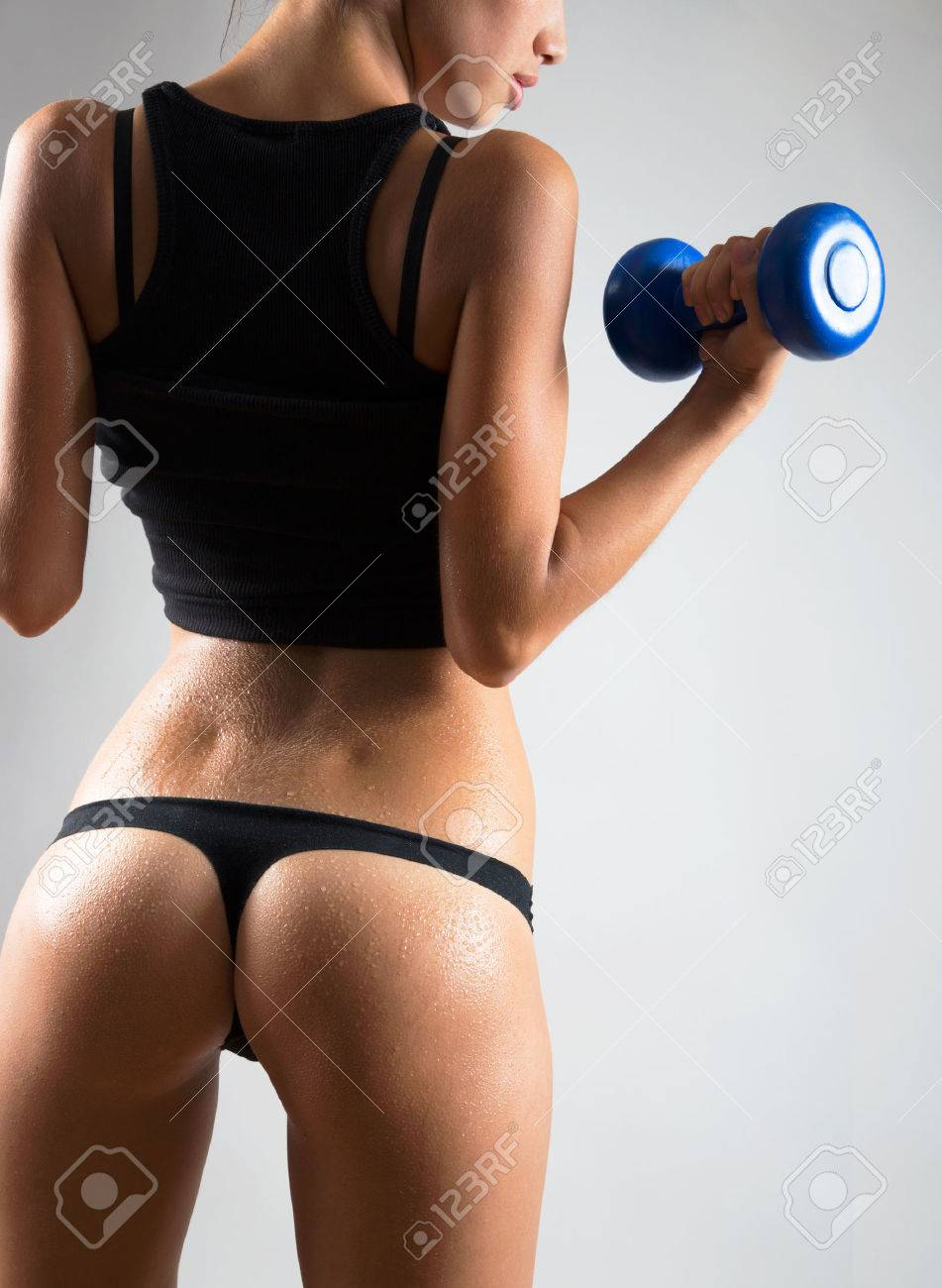 Fitness woman. Slim woman with dumbbells. Stock Photo - 23222614