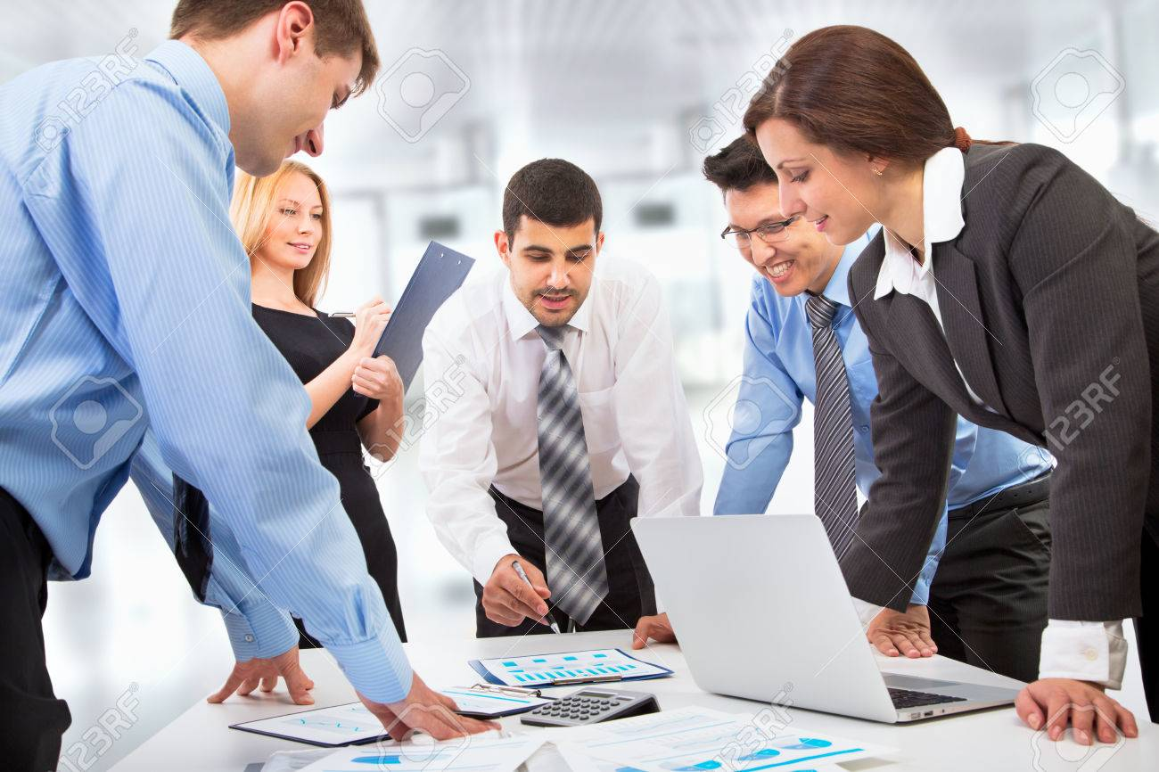 Business team working on their business project together at office Stock Photo - 23221814