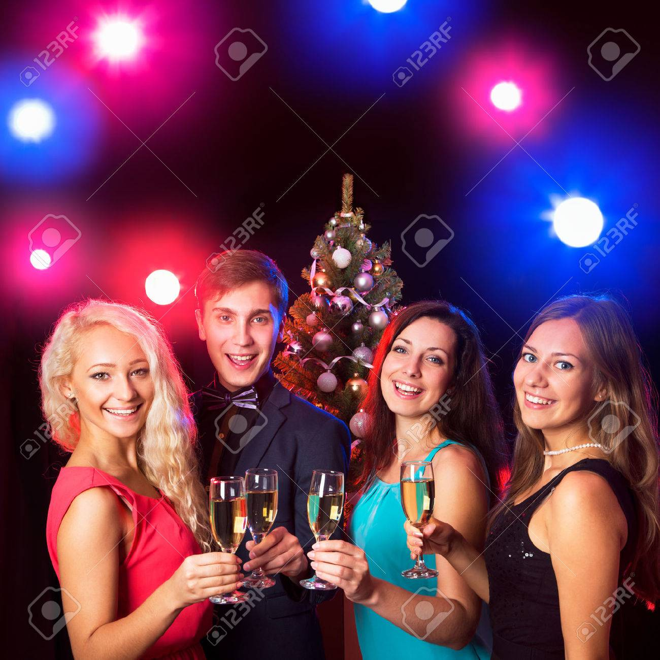 Happy people clinking by glases with each other Stock Photo - 23221931