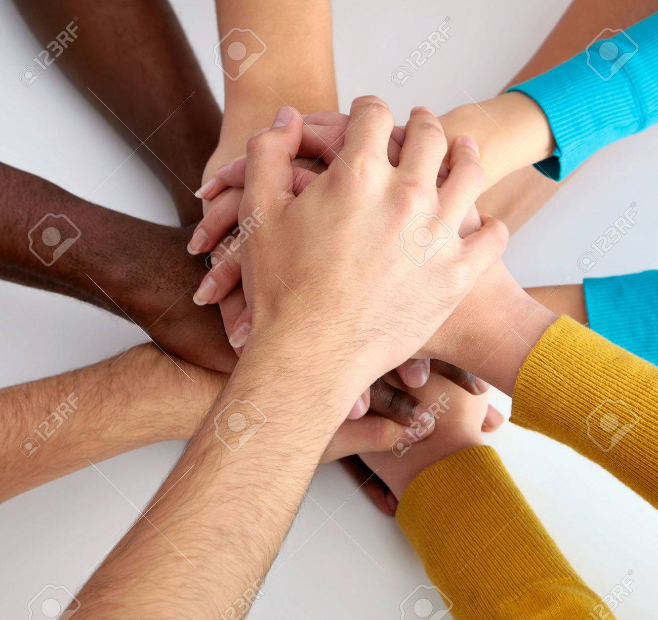 High view of team of friends showing unity with their hands together Stock Photo - 24849321