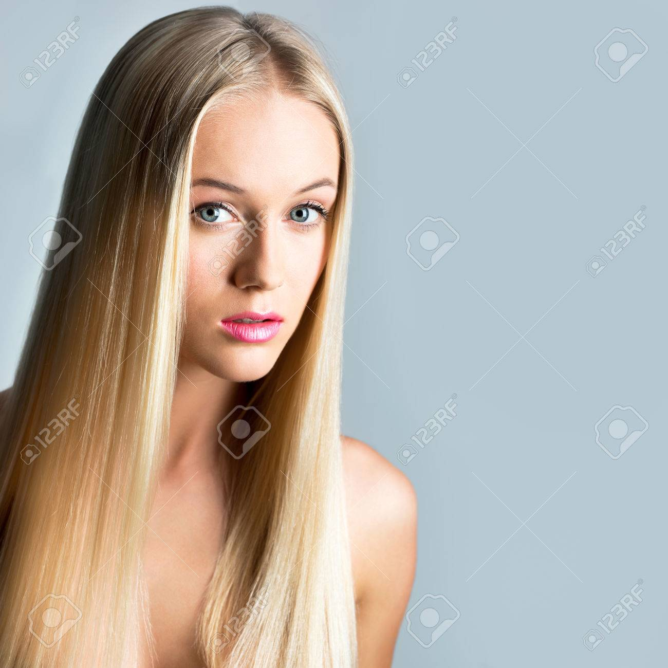 Beautiful young woman with a long hair - 29890530