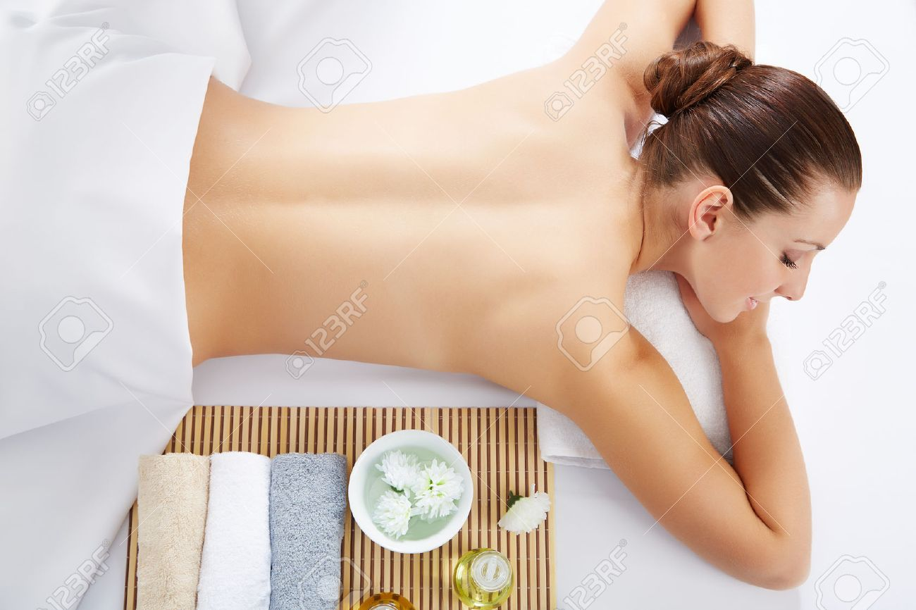 Healthy life. Young beautiful woman relaxed in spa environment Stock Photo - 29890499