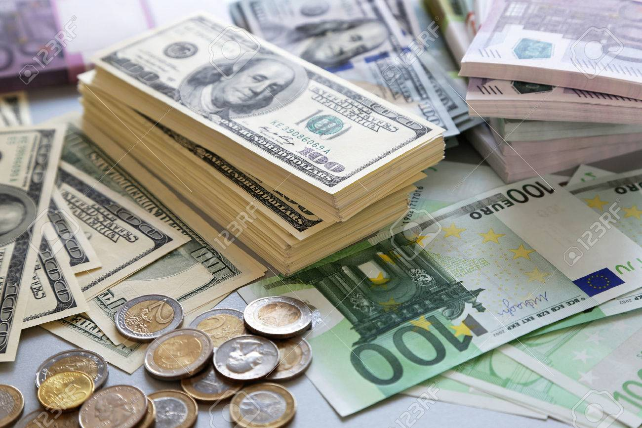 Lot of dollars and euros. Background and texture Stock Photo - 39467494