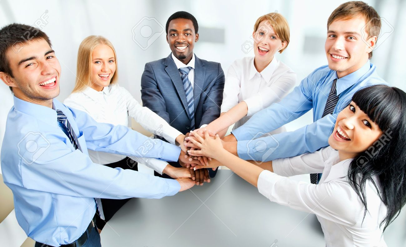 Business team showing unity with their hands together Stock Photo - 42150246