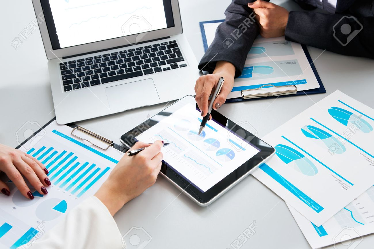 Image of human hands during paperwork at meeting Stock Photo - 43465384