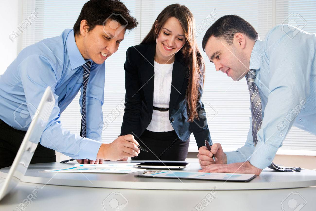 Business team working on their business project together at office Stock Photo - 42768385