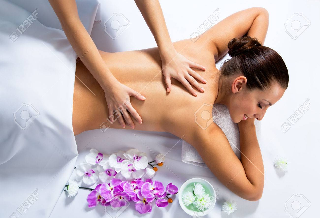 Masseur doing massage on woman face in the spa salon. Beauty treatment concept. Stock Photo - 42768386