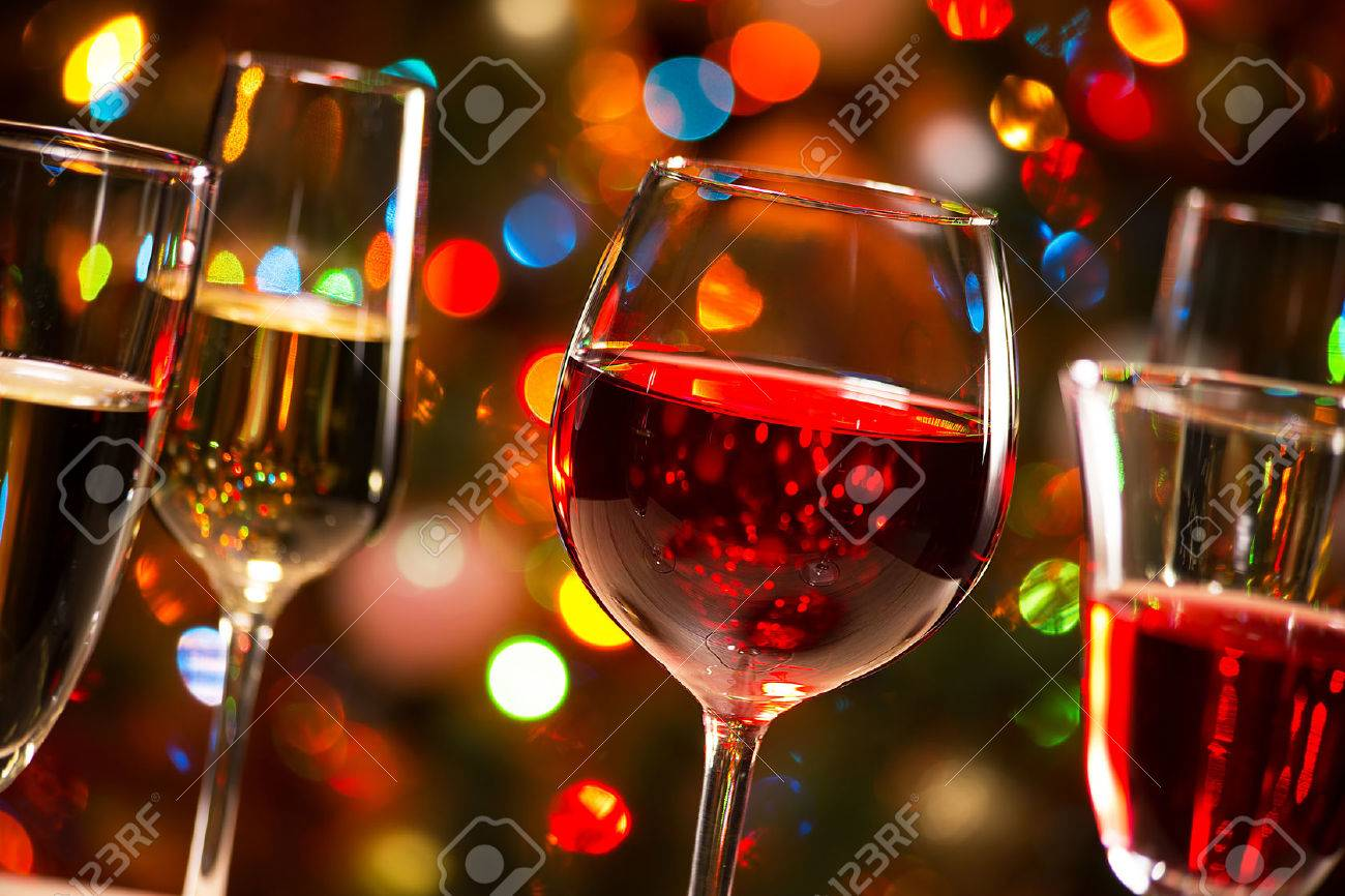 Crystal glasses of wine on the background of Christmas lights Stock Photo - 48232017