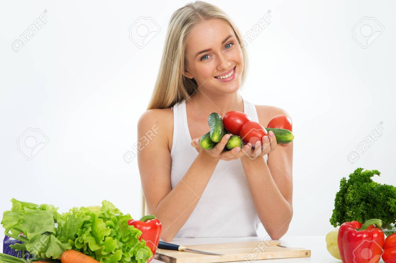 Young smiling pretty woman with vegetables - 128764327