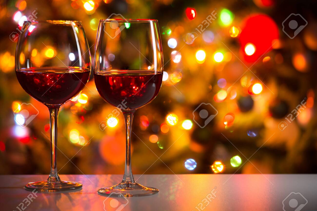 Crystal glasses of wine on the background of Christmas lights - 133410752