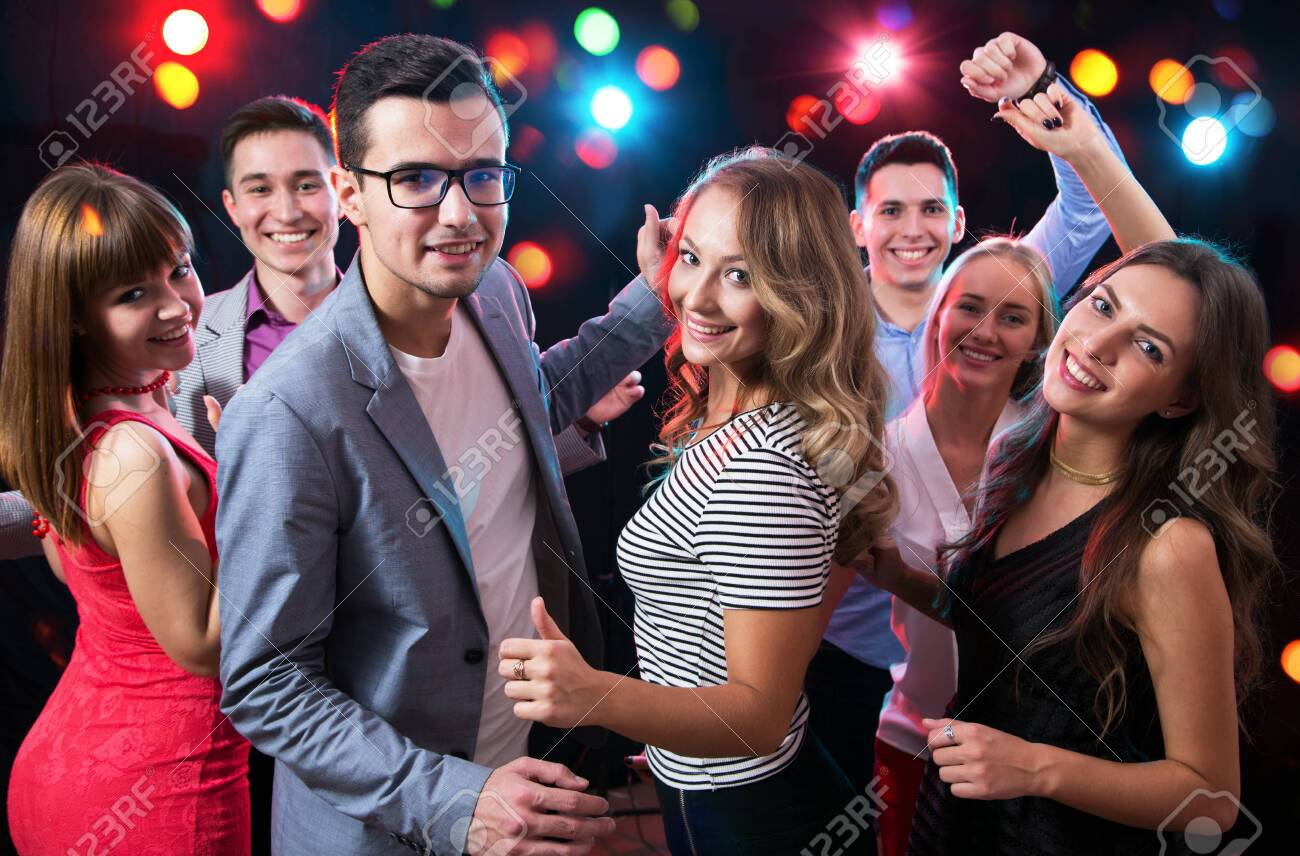 Group of happy young people having fun dancing at party. - 133659905