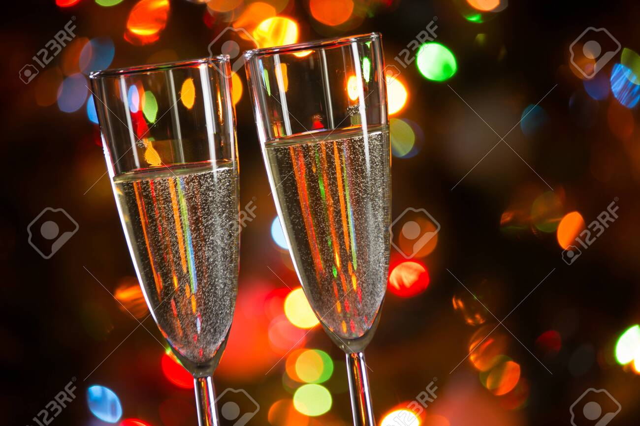 Champagne glasses on the background of Christmas lights - 134212413