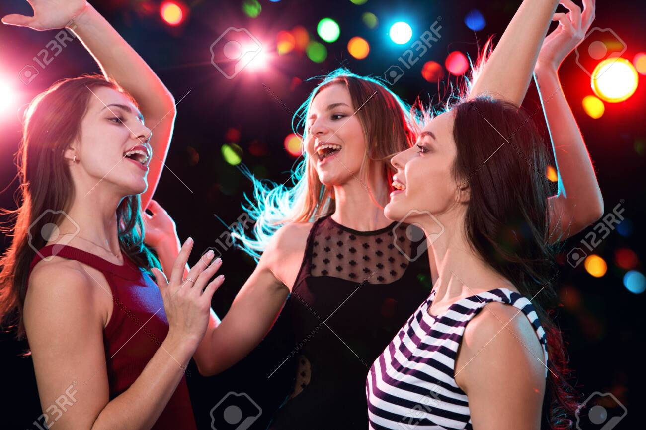 Happy beautiful girls have fun at a Christmas party - 133843649