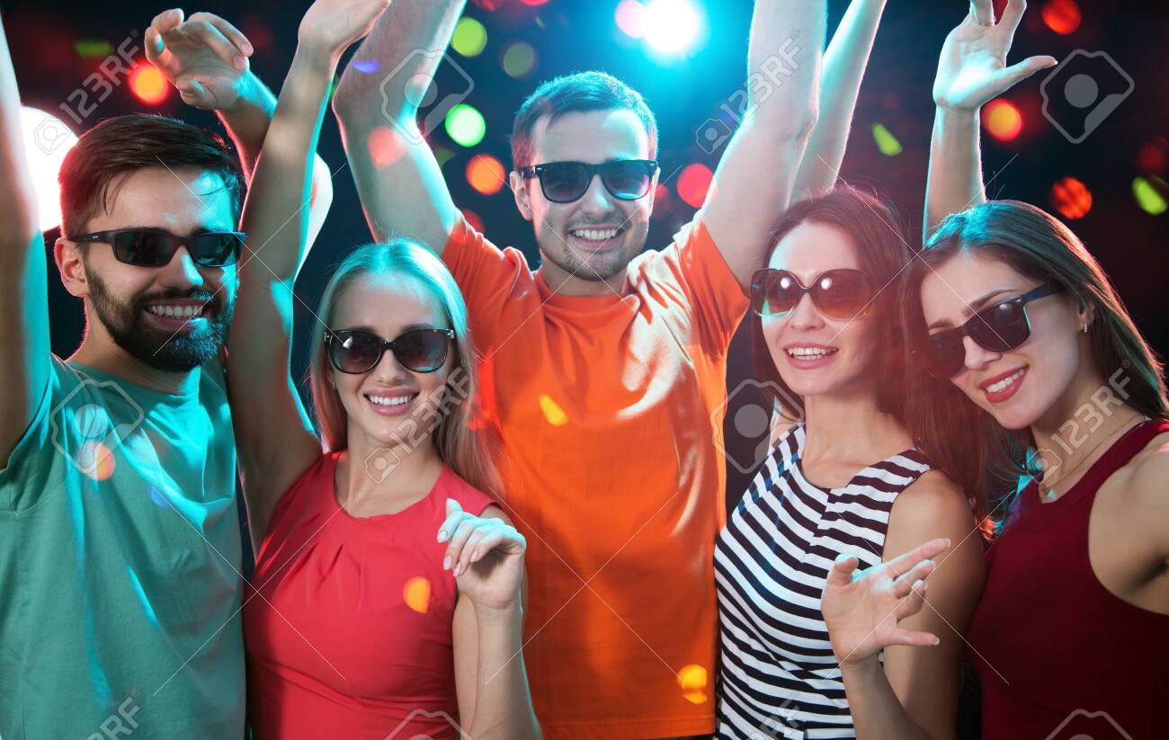 Group of happy young people having fun at party. - 135262724