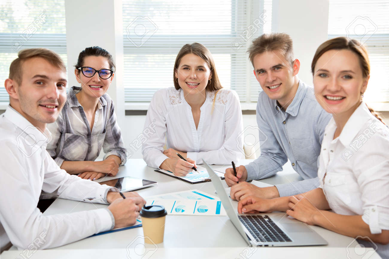 Young business people in office smiling looking at camera - 146272366