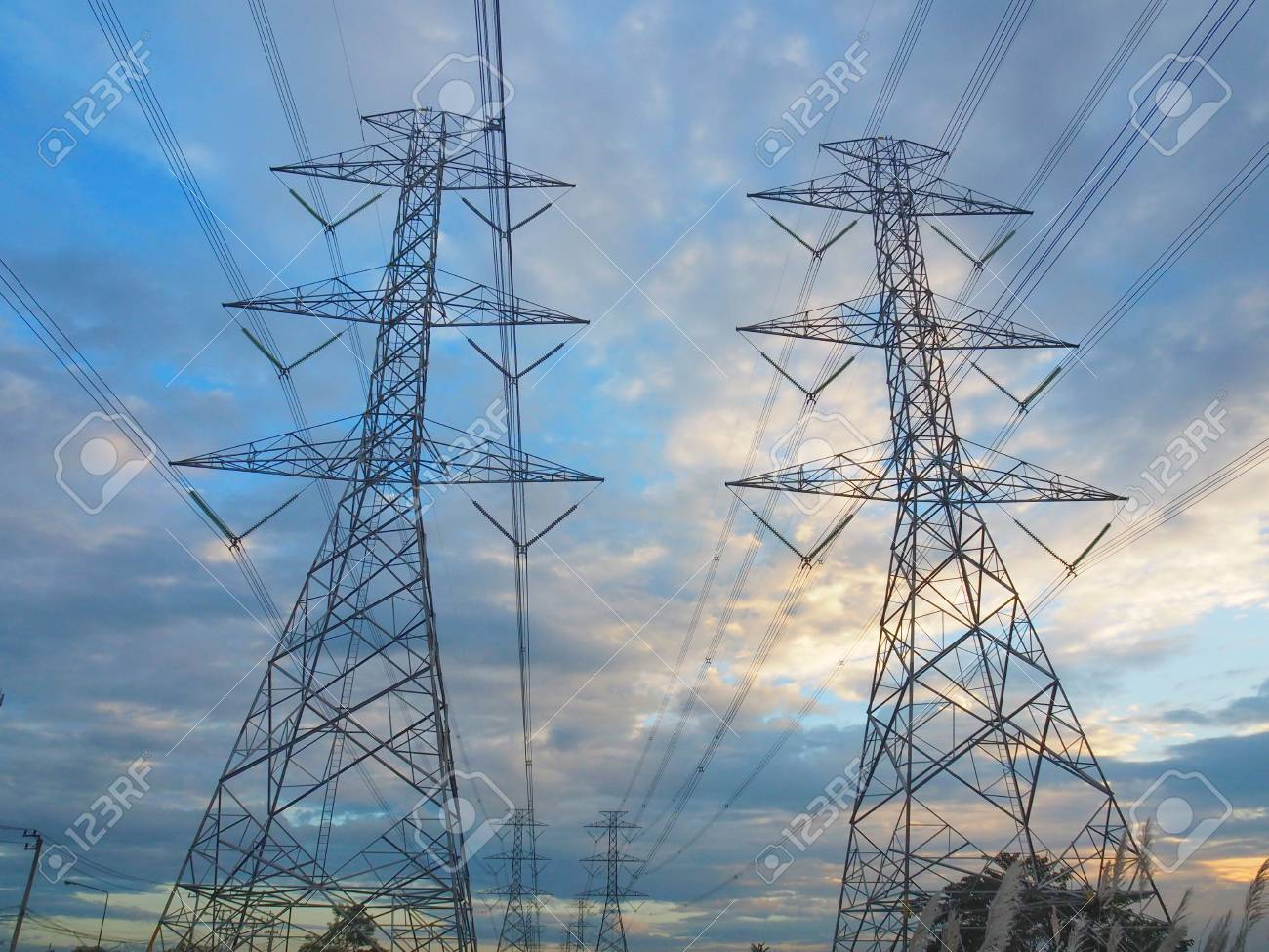 High Power Transmission Towers In The Fields At Sunset And Beautiful Stock Photo Picture And Royalty Free Image Image 102013920