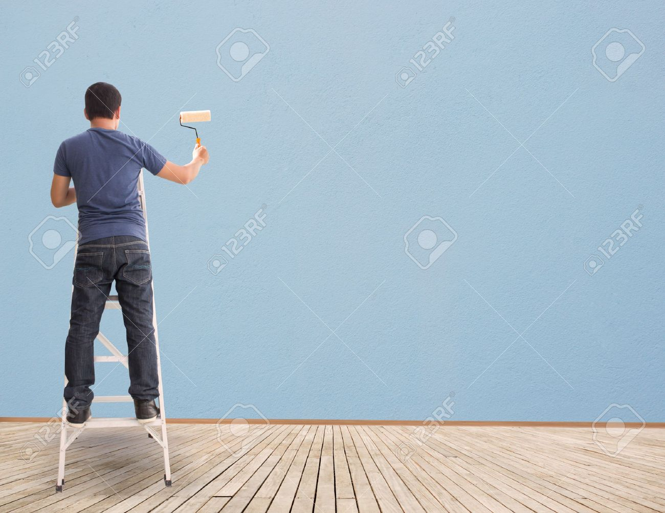 Man Painting On Blue Wall,Concept And Ideas Stock Photo - 19387512
