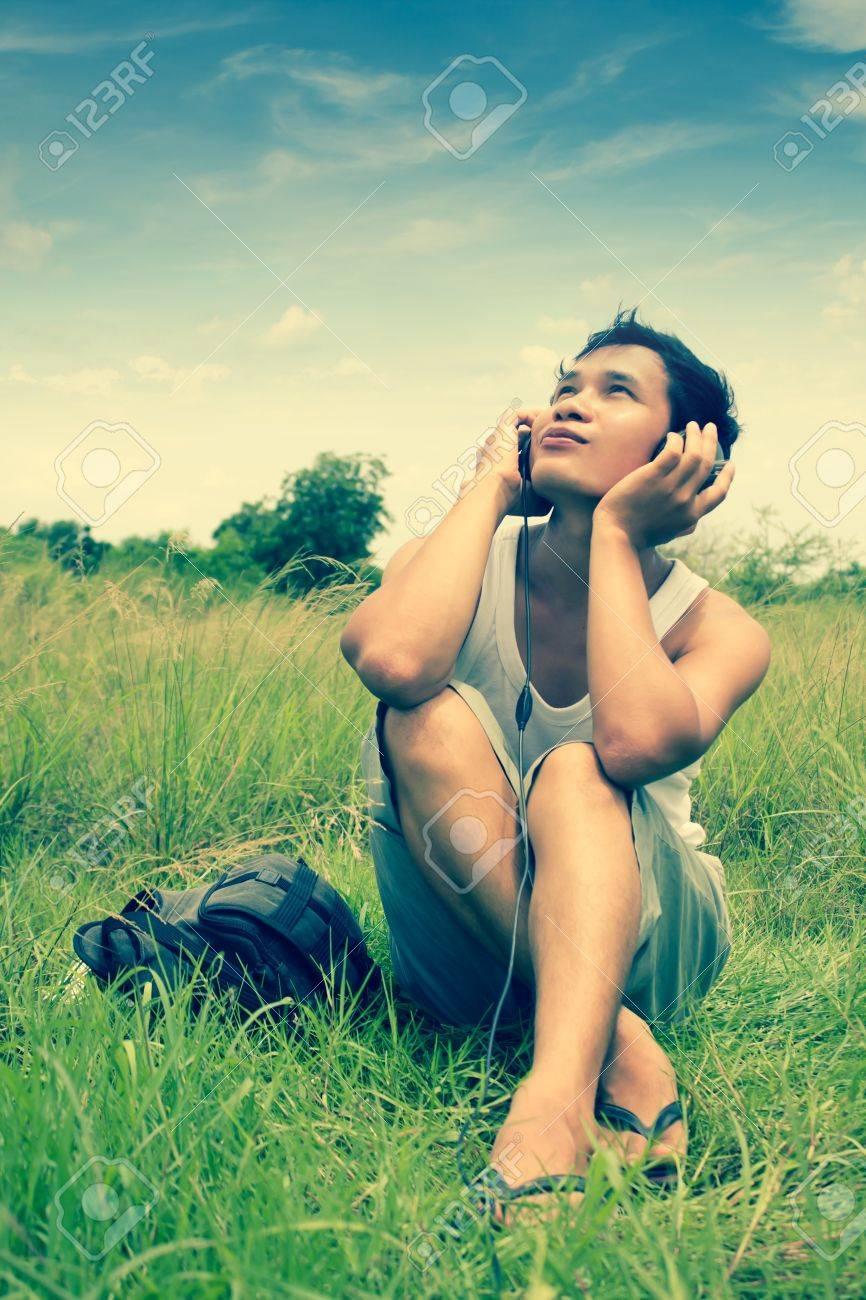 Man Listening To Music Series,Gay Sensation,Dramatic Look Stock Photo -  20405432