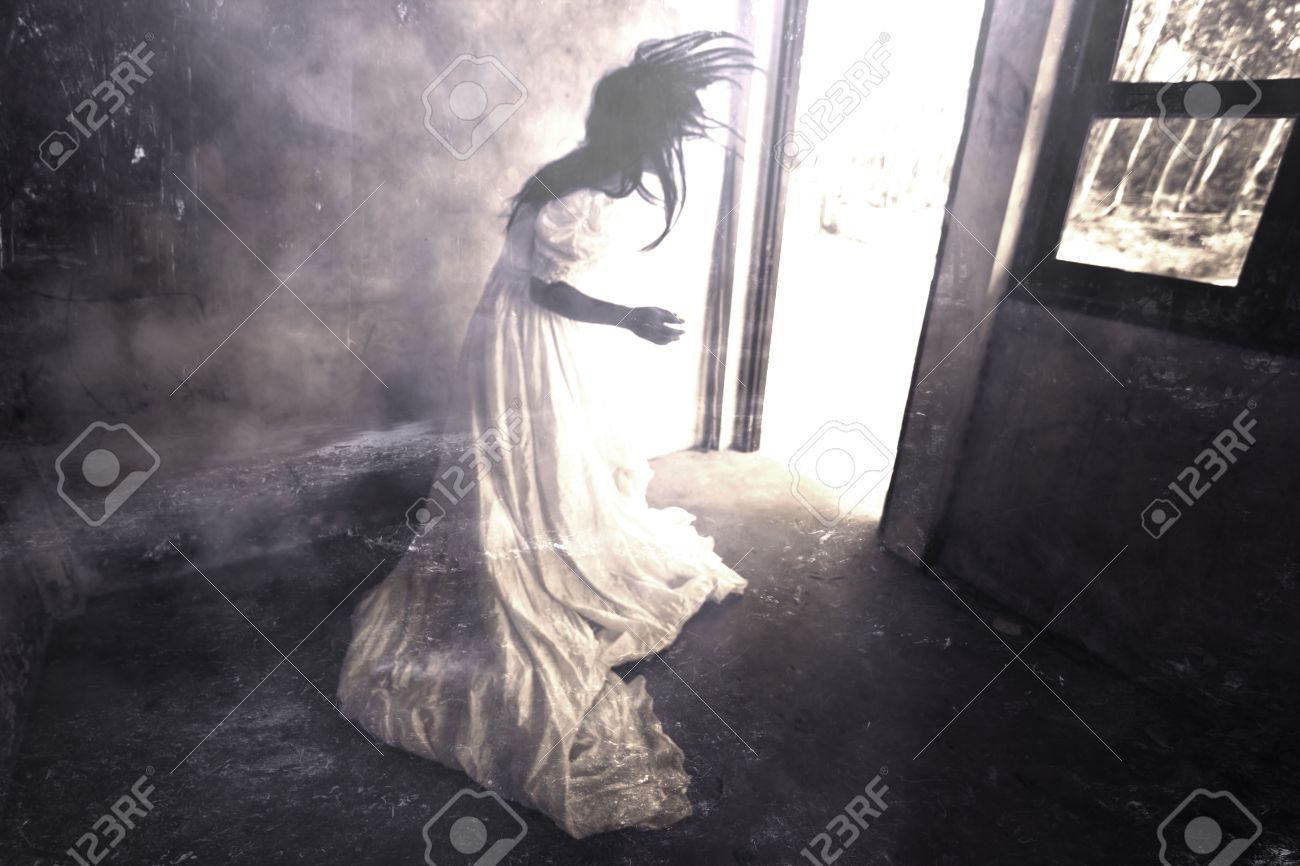 Ghost in Haunted House,Mysterious Woman in White Dress Standing in Abandon Building,Horror Background For Halloween Concept and Book Cover Ideas - 49544007