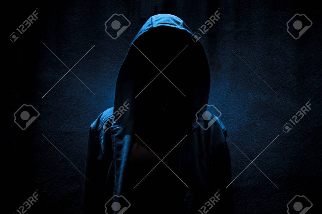 Woman wearing hoodie hiding in the dark,Scary background for book cover - 62241486