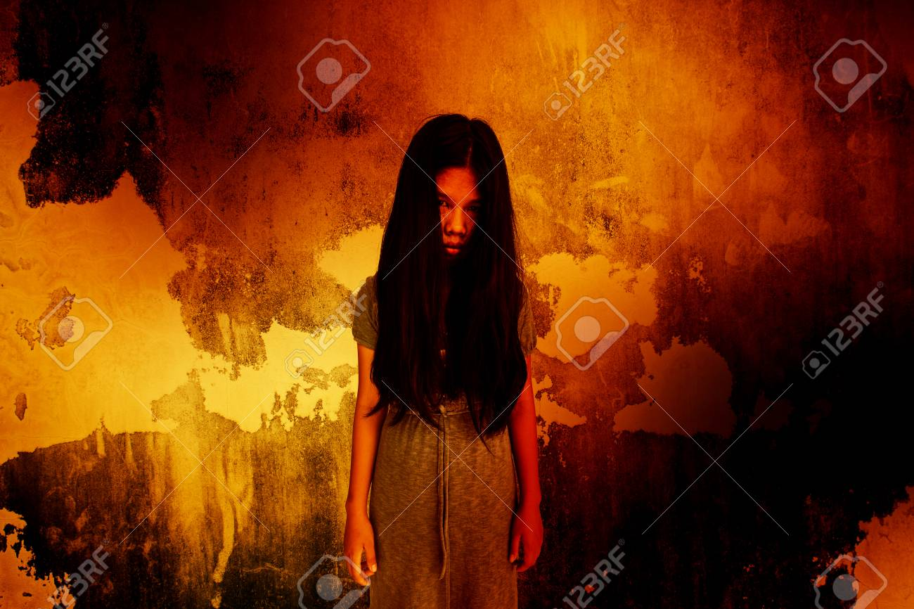 ghost girl standing in front of the wall,scary background for