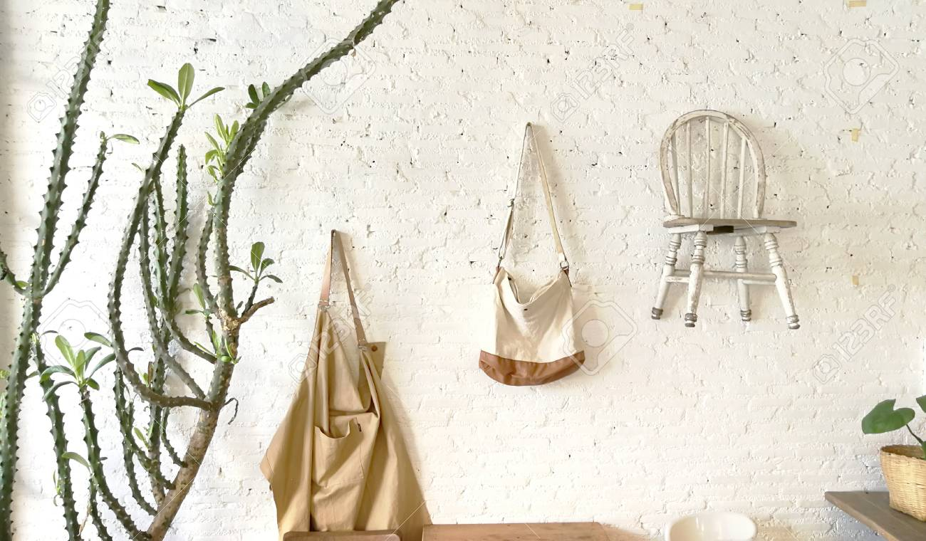 Hand Bag Vintage Wood Chairs Hanging Decoration White Brick Stock Photo Picture And Royalty Free Image Image 126120223