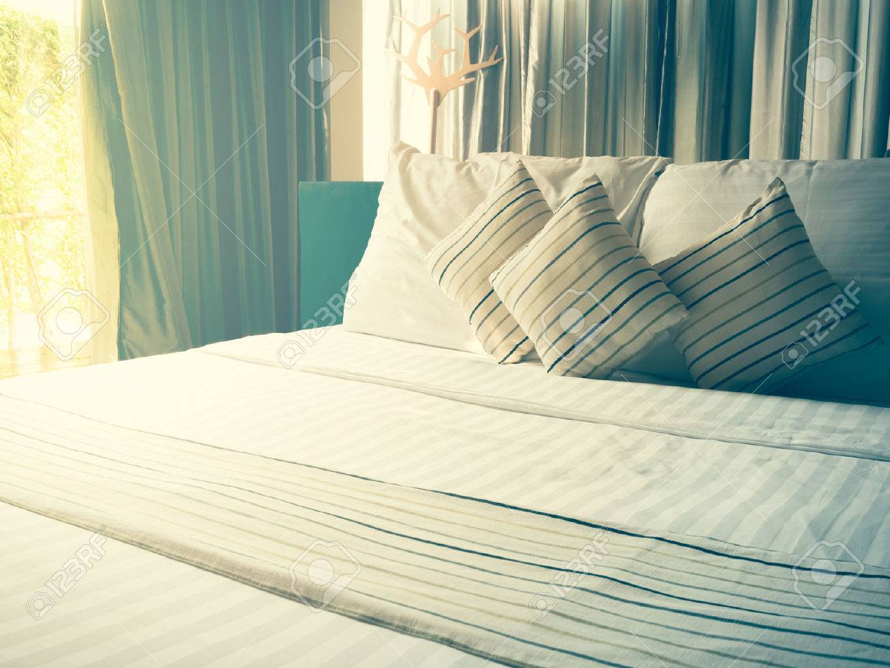 Vintage Bed Sheets And Pillow Messed Up In The Morning Stock Photo