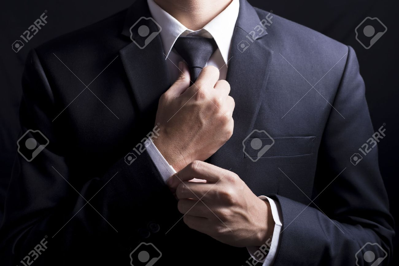 Businessman Adjust Necktie his Suit - 50925951