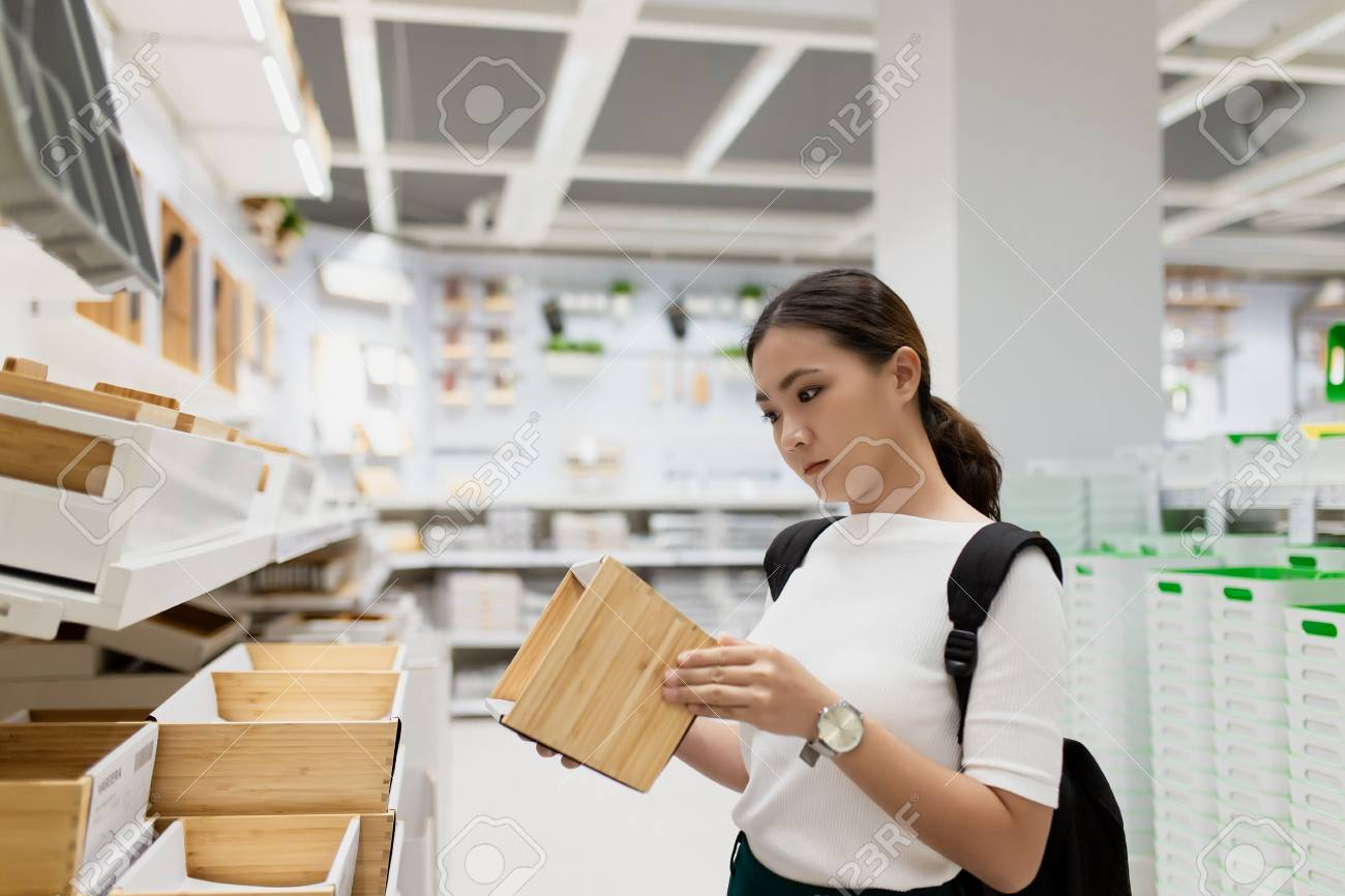 Woman shopping and choose the decorative for home office - 117930090