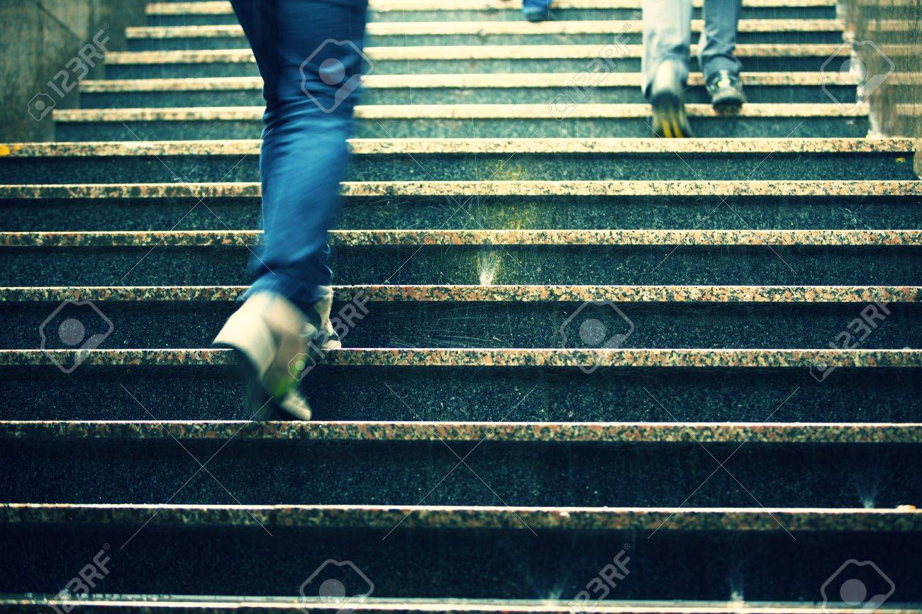 People on the staircase in rain - blurred motion Stock Photo - 20465347
