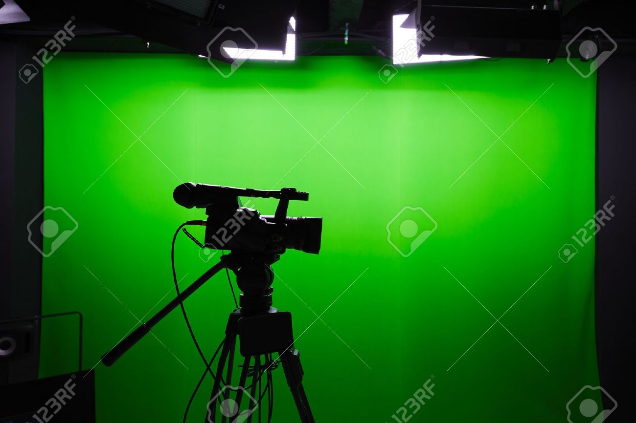 Silhouette of digital video camera in front of the green screen Standard-Bild - 47464278