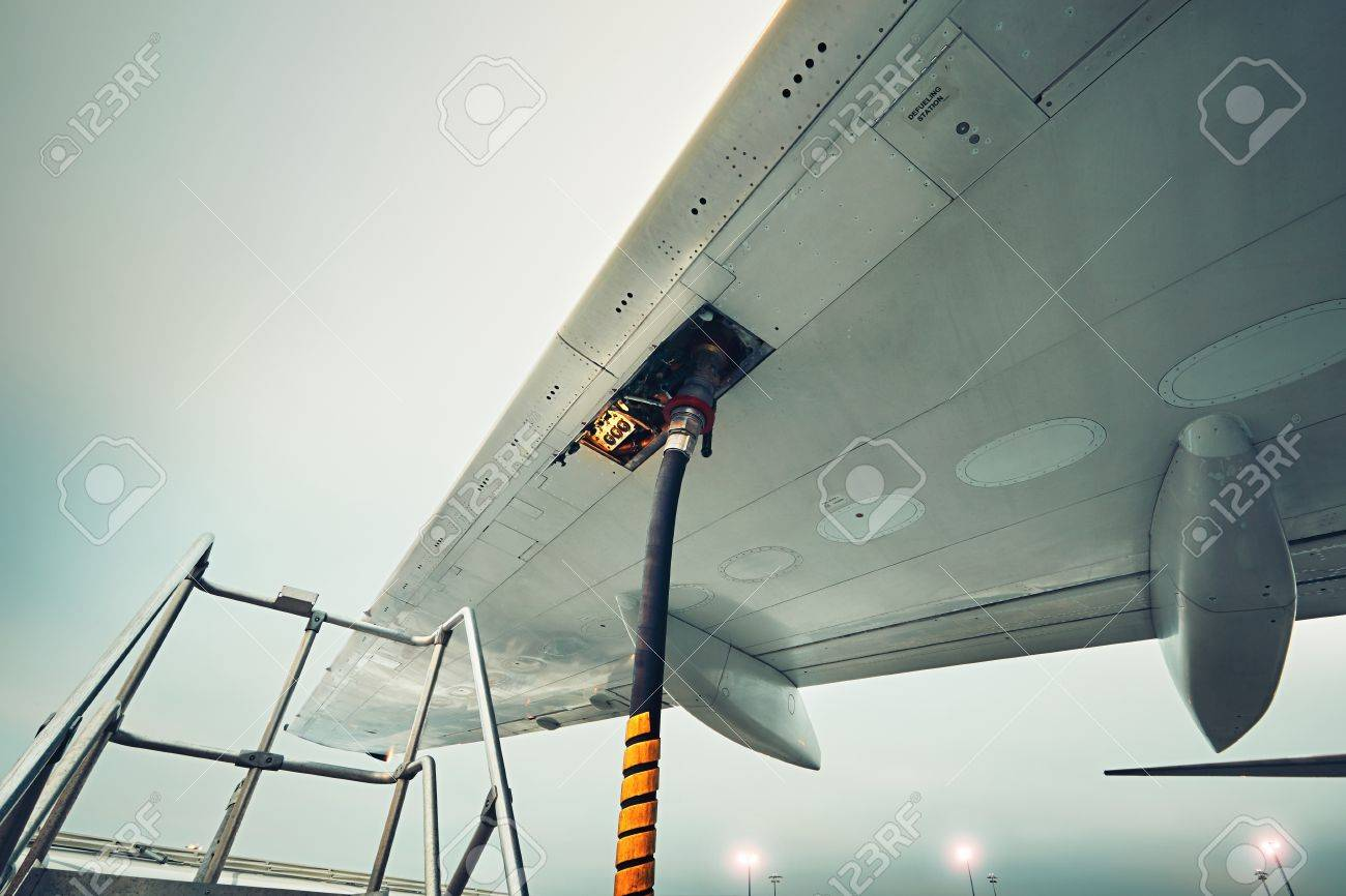 Process of the refueling passenger plane at the airport - 68202270